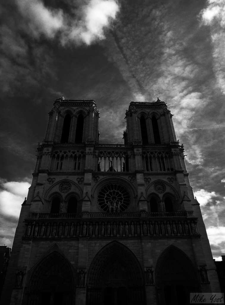 notre dame front clouds